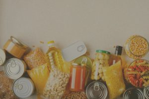 how to stock your pantry on a budget with different pantry foods spread out on a table