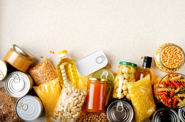 how to stock a pantry on a budget looking down on a table of canned and dried food