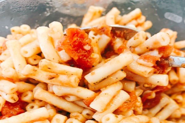 close up of tomatoes and macaroni noodles